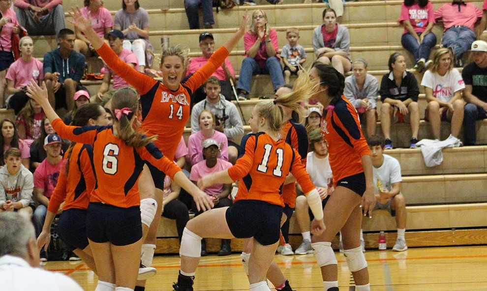 Sophomore+Olivia+Brees+celebrates+a+point+for+Baker.+The+Wildcats+won+the+match+in+four+sets.+Image+by+Elizabeth+Hanson.