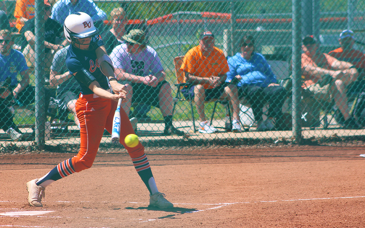 Sophomore+Caitlin+Hardgrove+makes+contact+with+a+pitch+during+her+time+at+bat.+Image+by+Justin+Toumberlin.