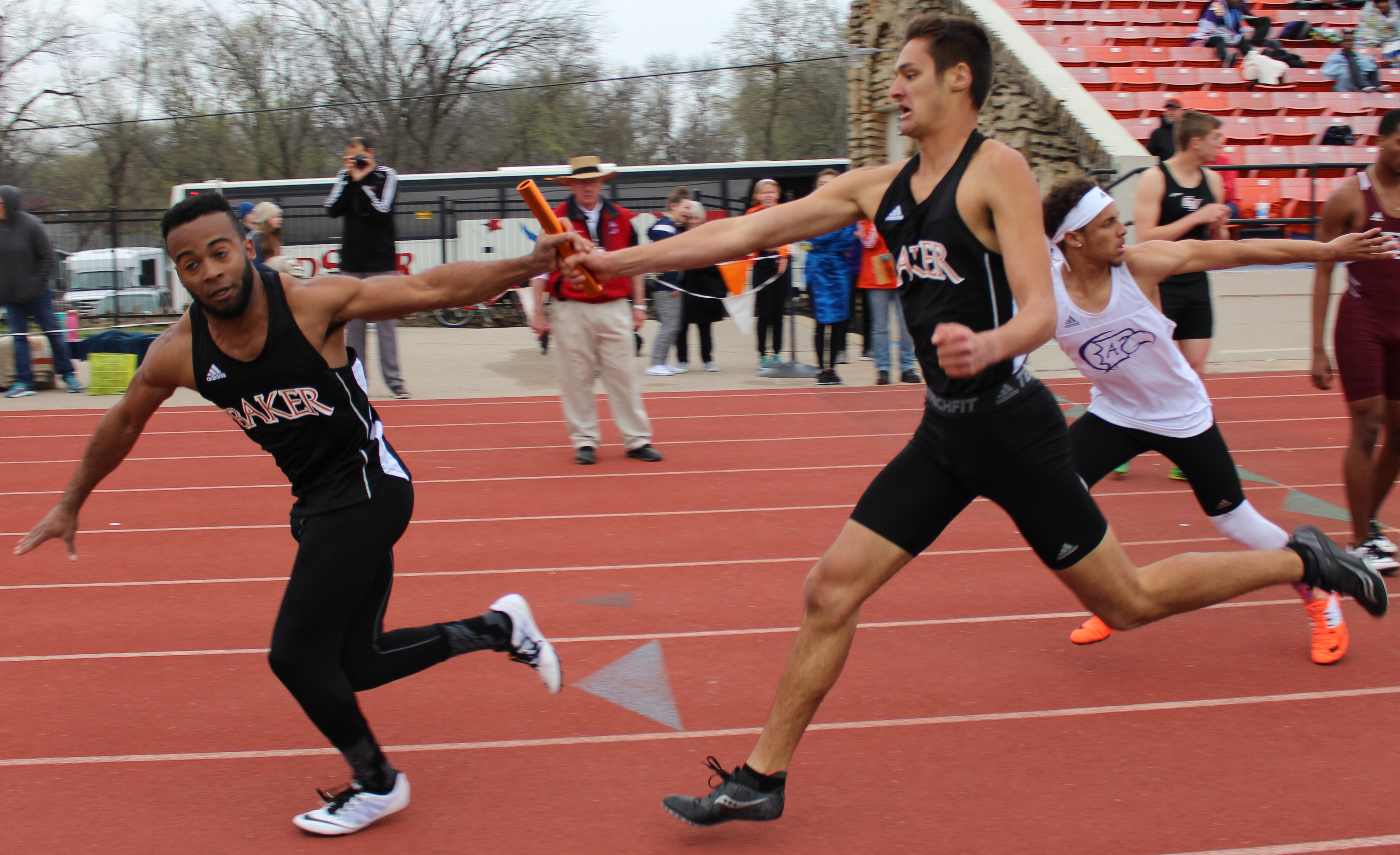 Freshman Danny Griese passes the baton to senior Avery Parker to gain fourth place overall in the men's 1,600-meter relay with a time of 3:30.28. Photo by Marilee Neutel.