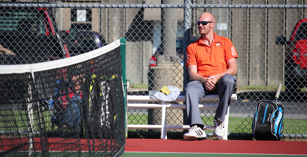 Head+tennis+coach+Keith+Pipkin+watches+a+match+Oct.+7+against+William+Jewell+College.+Pipkin+is+in+his+first+year+at+Baker.+Image+by+Jenna+Black.