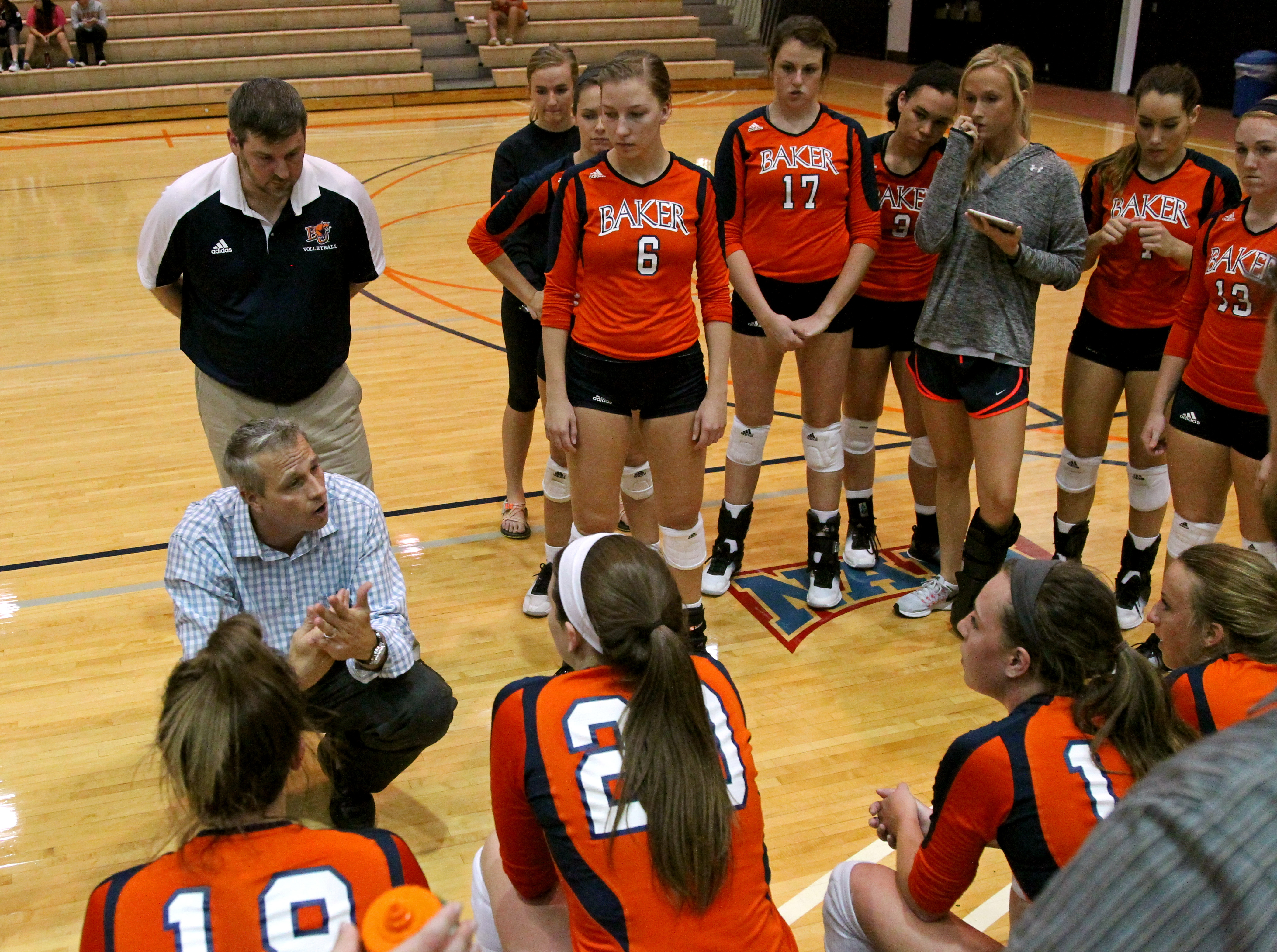 Head coach Matt Windle motivates the team during a timeout in the second set against Peru State on Sept. 13 in the Collins Center.
