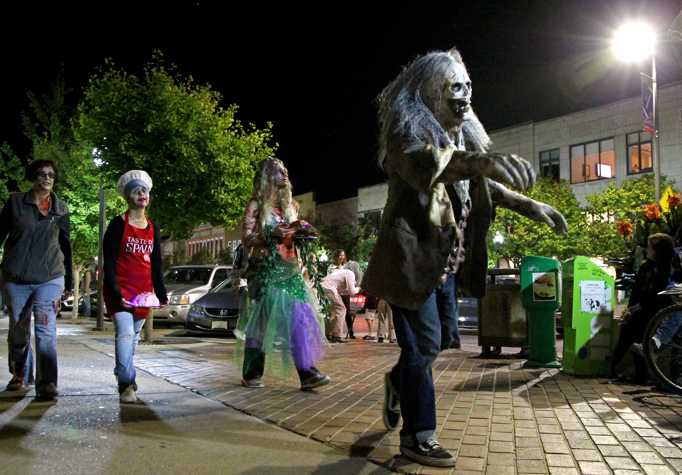 Zombies walk along Massachusetts as part of the Zombie Walk on Oct. 20 in downtown Lawrence. Image by Chad Phillips.