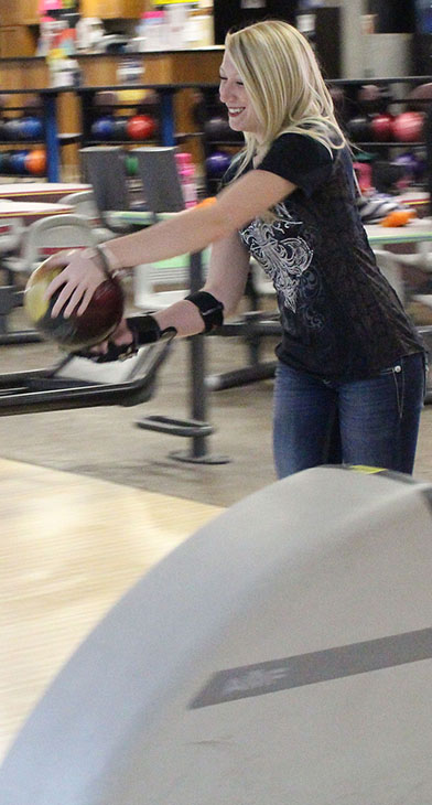 Junior Chenoa Rhades prepares for another shot during a bowling practice session. Image by Marilee Neutel.