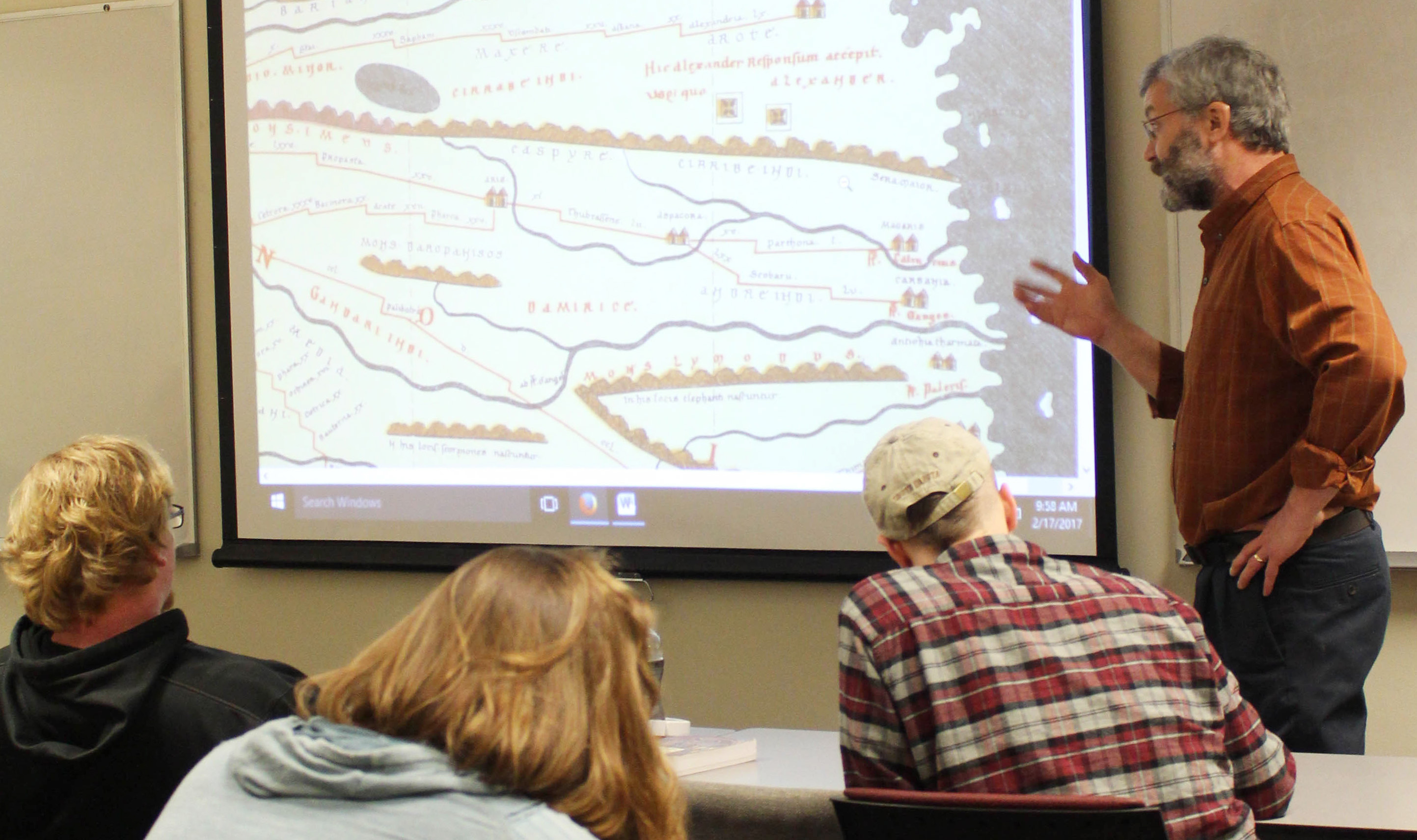 John Richards, chair of the Department of History, Culture and Society, teaches his class on