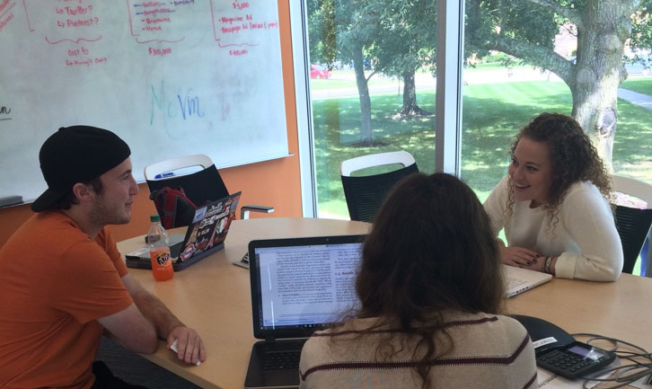 Thomas Irick, Alyssa Glover and Annie Hanson study in the Long Student Center study rooms on a Wednesday afternoon.