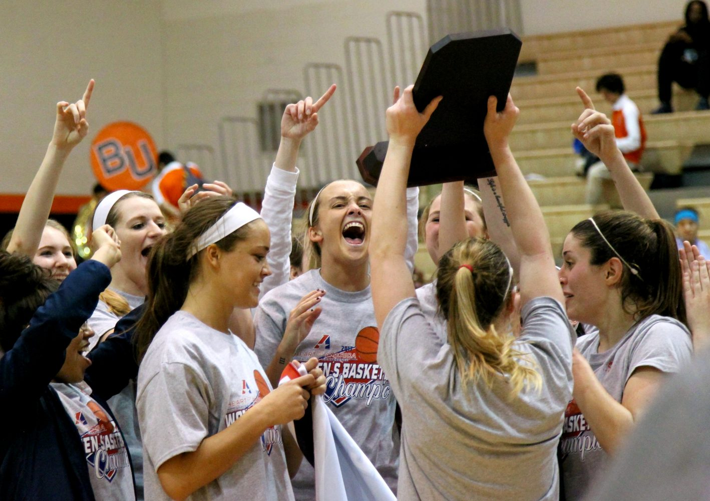 The women's basketball team celebrates winning the Heart of America Athletic Conference Tournament for the first time in program history. The team added this achievement to the list for another history-making season. Photo by Chad Phillips.