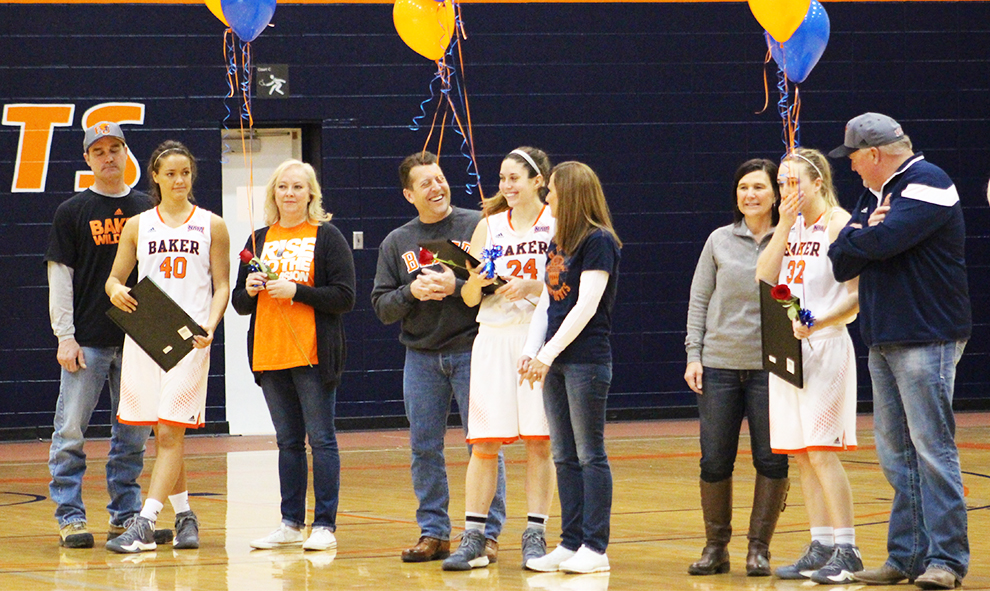 Seniors+MacKenzie+Cook%2C+Sydney+Buchel+and+Kelsey+Larson+were+honored+before+the+women%27s+basketball+game+against+Grand+View+University+on+Feb.+25.+The+Wildcats+defeated+the+Vikings+77-59.+Photo+by+Elizabeth+Hanson.