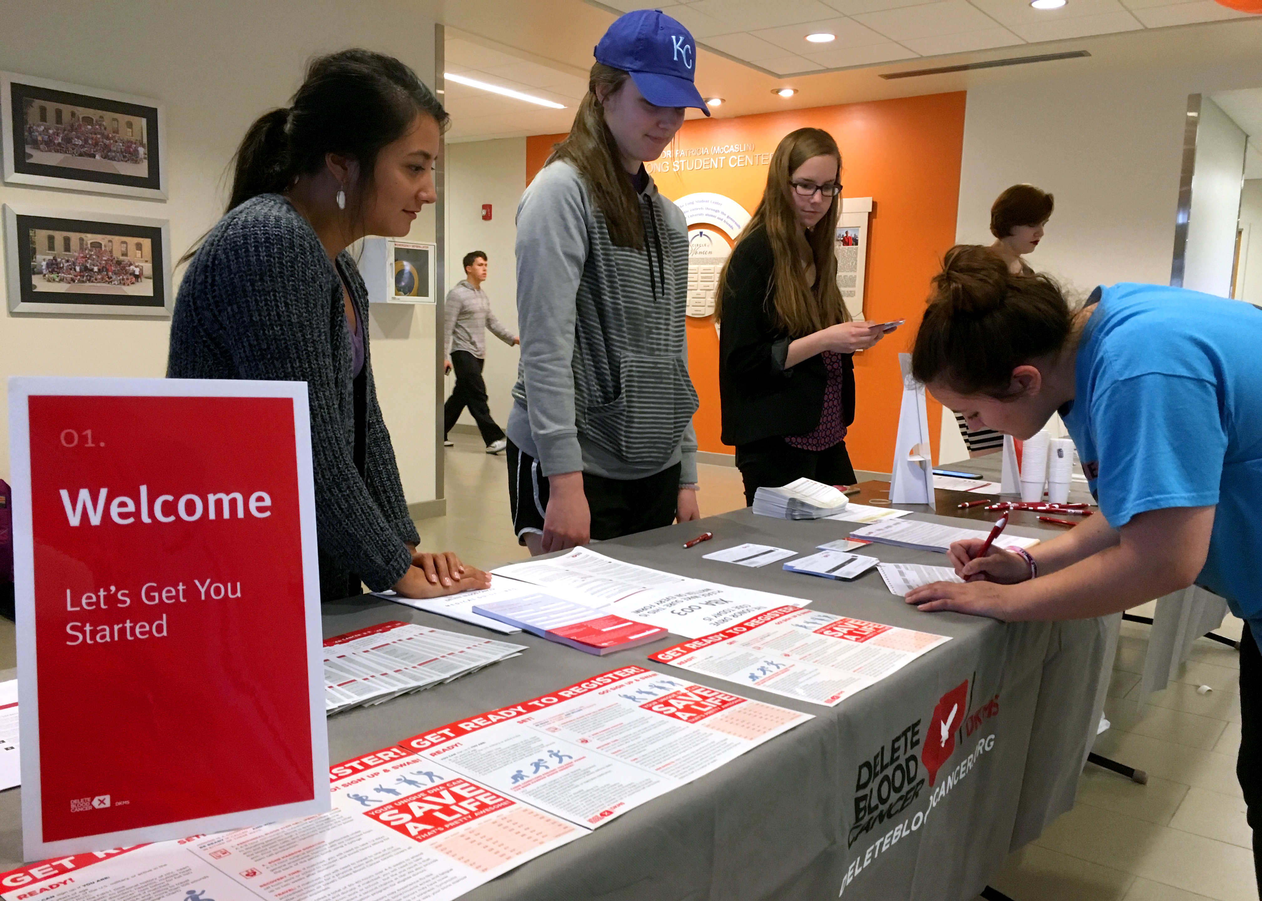 Graduate Assistant Gabby Garrison and freshman Emily Riggs help freshman Kendall Stelting sign up to be a bone marrow donor on March 8 in the Long Student Center. The chance of being a match is rare, but could help save the life of someone battling blood cancer.