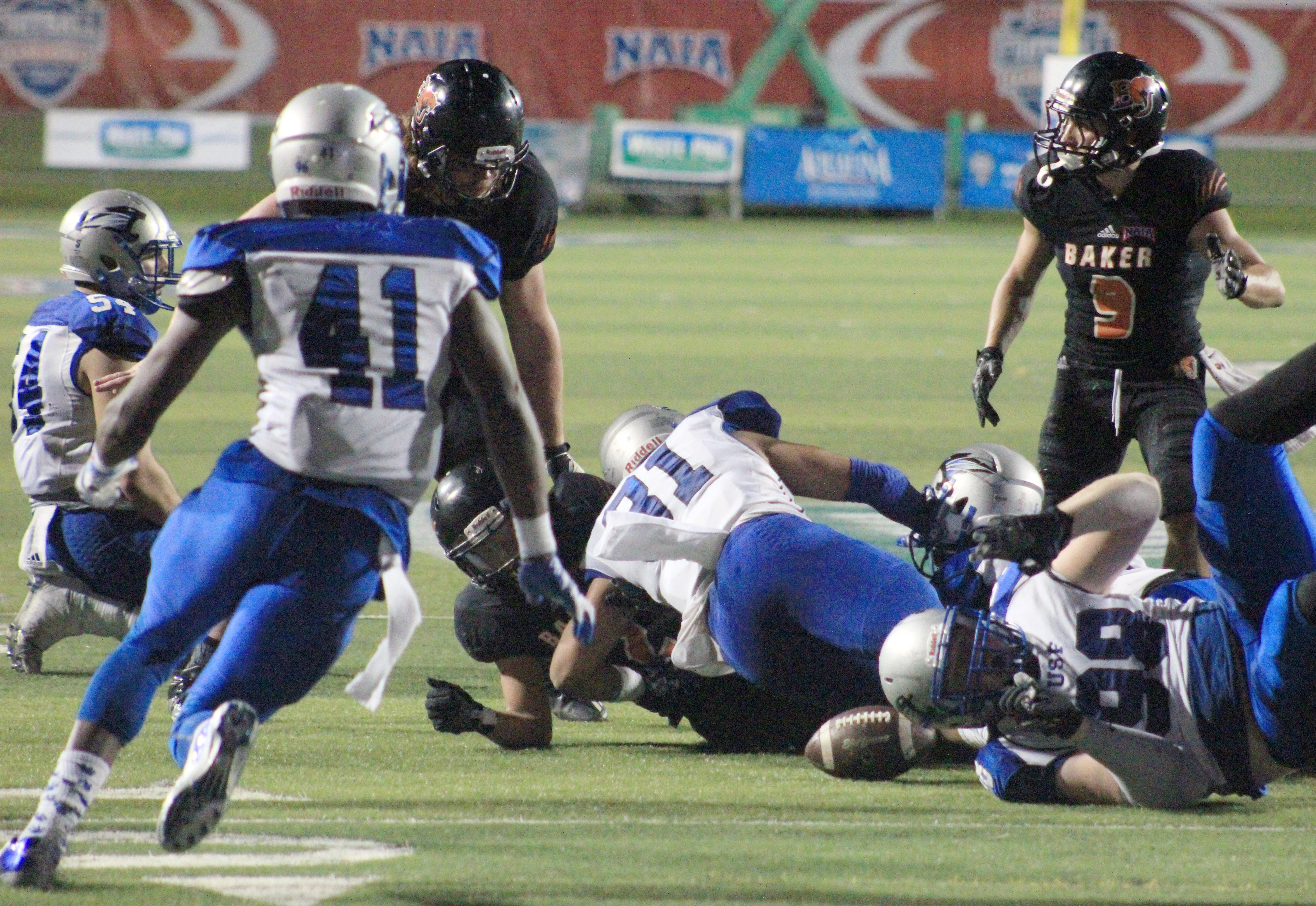 Saint Francis forces a Cornell Brown fumble in the fourth quarter of the national title game in Daytona Beach, Florida. The Cougars forced two Baker turnovers in their 38-17 win. Image by Shelby Stephens.
