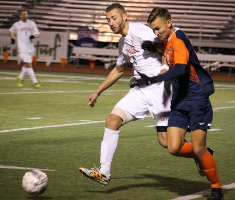 Men's soccer wins first game