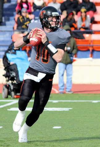 Morse coaches quarterbacks in return to Baker