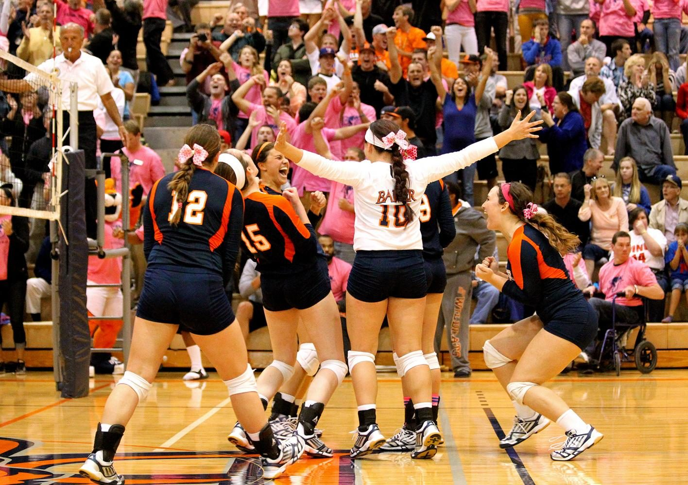 The volleyball team celebrates winning a point during the Pink Out game against rival MNU on Oct. 15, 2013, in Collins Center. The proceeds from the game benefited Baker volleyball alumna Katie Jaschke, who had been recently diagnosed with breast cancer. The rowdy crowd made this one of the most entertaining events to cover, and it was incredible to see the Baker community rally together to help a former player.