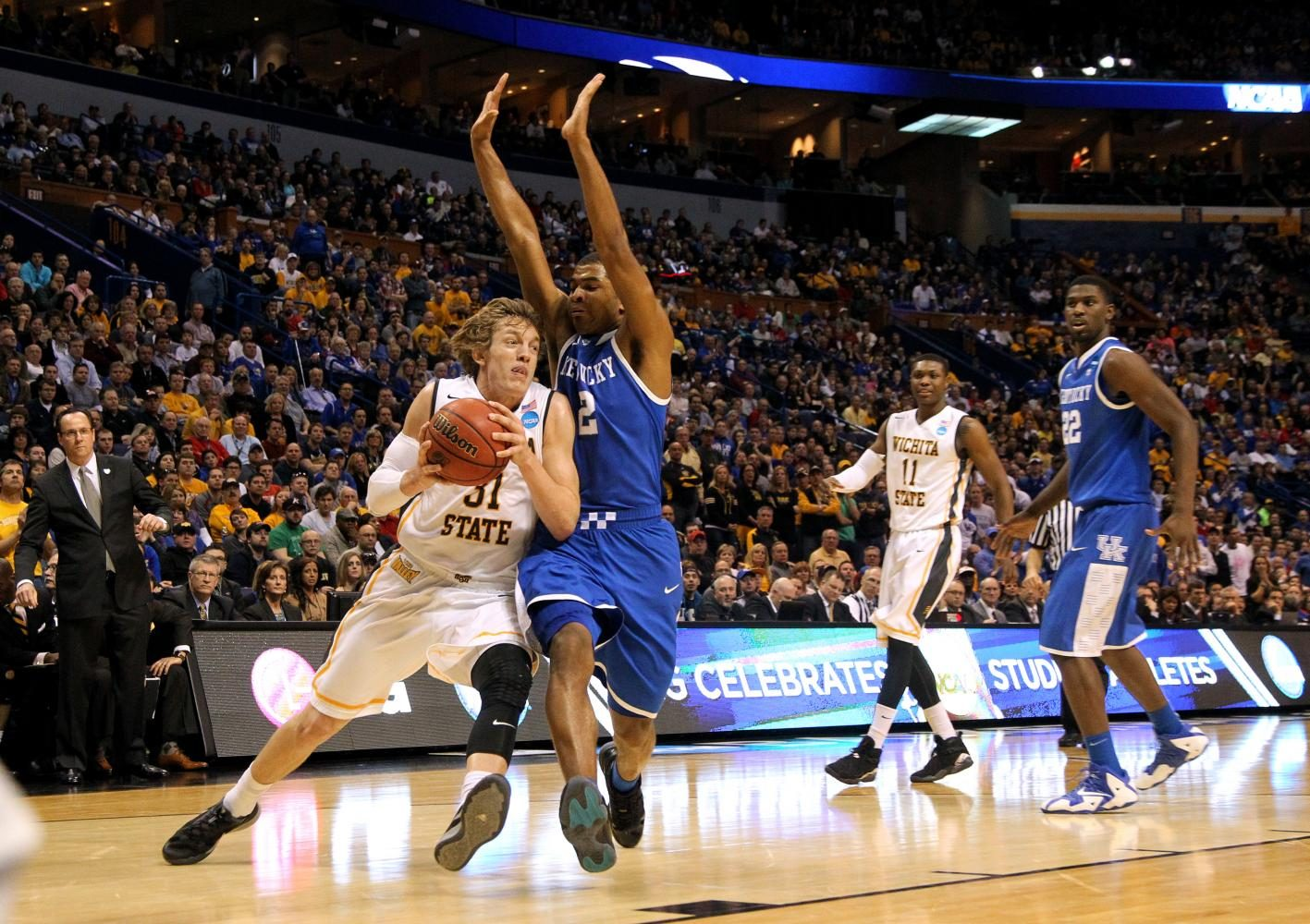 Wichita State University sophomore guard Ron Baker drives to the basket against University of Kentucky freshman guard Andrew Harrison on March 23, 2014, at the Scottrade Center in St. Louis, Missouri. The Shockers lost the game by two points, as sophomore guard Fred Van Vleet missed the potential game-winning 3-pointer at the buzzer, and the Wildcats would go on to make it to the national championship game. This game was often regarded as the best, most thrilling game of the entire tournament. The local Wichita magazine, Splurge! Magazine, gave me the opportunity to photograph the first and second round games of the 2014 March Madness tournament because all three Division 1 Kansas schools competed in St. Louis that weekend. I will never forget being on the sidelines alongside ESPN and Sports Illustrated photographers. I was able to photograph so many great college players like Andrew Wiggins, Perry Ellis, Wayne Selden, and Joel Embiid (although he was injured) from Kansas, and Willie Cauley-Stein, Julius Randle, and the Harrison twins from Kentucky. While I didn't cover this for The Baker Orange, I did publish a gallery and article about my unbelievable experience.