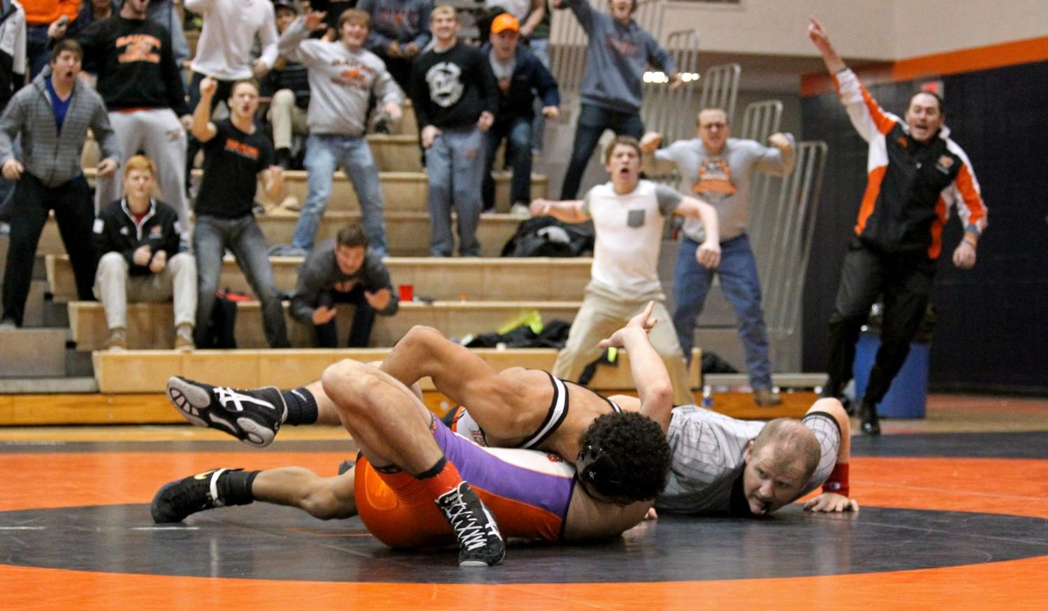 Freshman Juan Rivera attempts to pin Missouri Valley Colleges Todd Brackett while the crowd cheers him to victory on Nov. 15, 2014, in Collins Center. Baker upset No. 4 ranked MVC 28-13 in the HAAC Quad. Photographing wrestling almost always ensures several passionate and emotional photos, and this match did not disappoint.