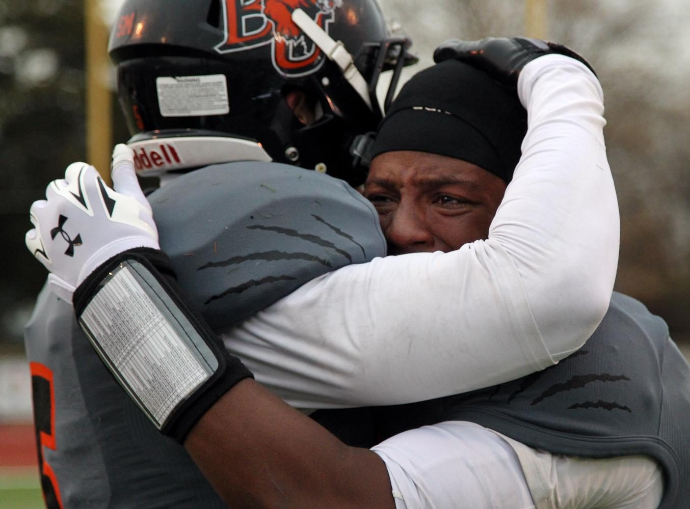 Senior Aundre Allen is comforted by a teammate after losing the last game of his college career to Missouri Valley College on Nov. 15, 2014, at Liston Stadium. Baker fell 27-24 after a late field goal, eliminating the Wildcats from qualifying for the playoffs. Taking photos after a tough loss is never something I want to do, but sometimes it results in even more powerful moments than after a win.
