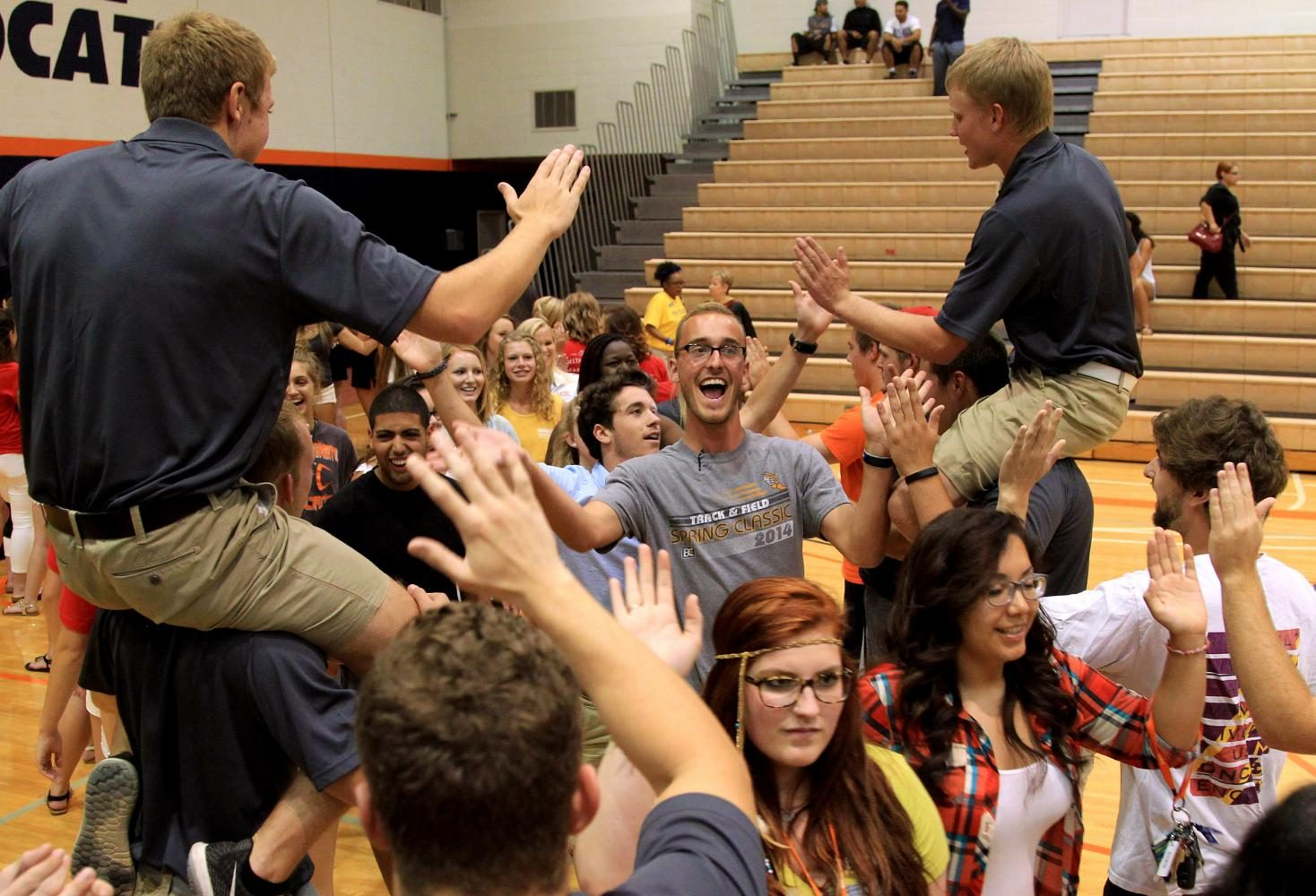 Freshman Cole Stallard walks through a tunnel of current Baker students and claps the hands of Wildcat Welcome Orientation Leaders Michael Riddle and Aaron Brooks prior to Playfair on Aug. 23, 2015, in Collins Center. The start to the school year is always an exciting time for everyone, and I think Cole's reaction captures this excitement perfectly.