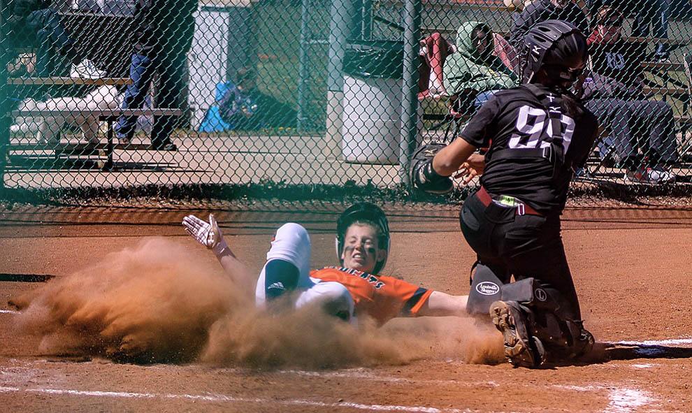 Softball team swept by Evangel