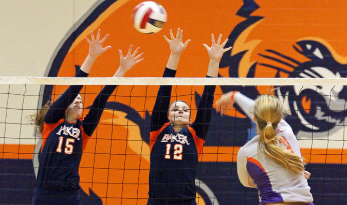 Sophomore Shannon Bond and senior Crystal Simon jump to block a spike during the match against Missouri Valley on Sept. 17 in Collins Gym. Baker won in three straight sets, handing Missouri Valley its first loss of the season.