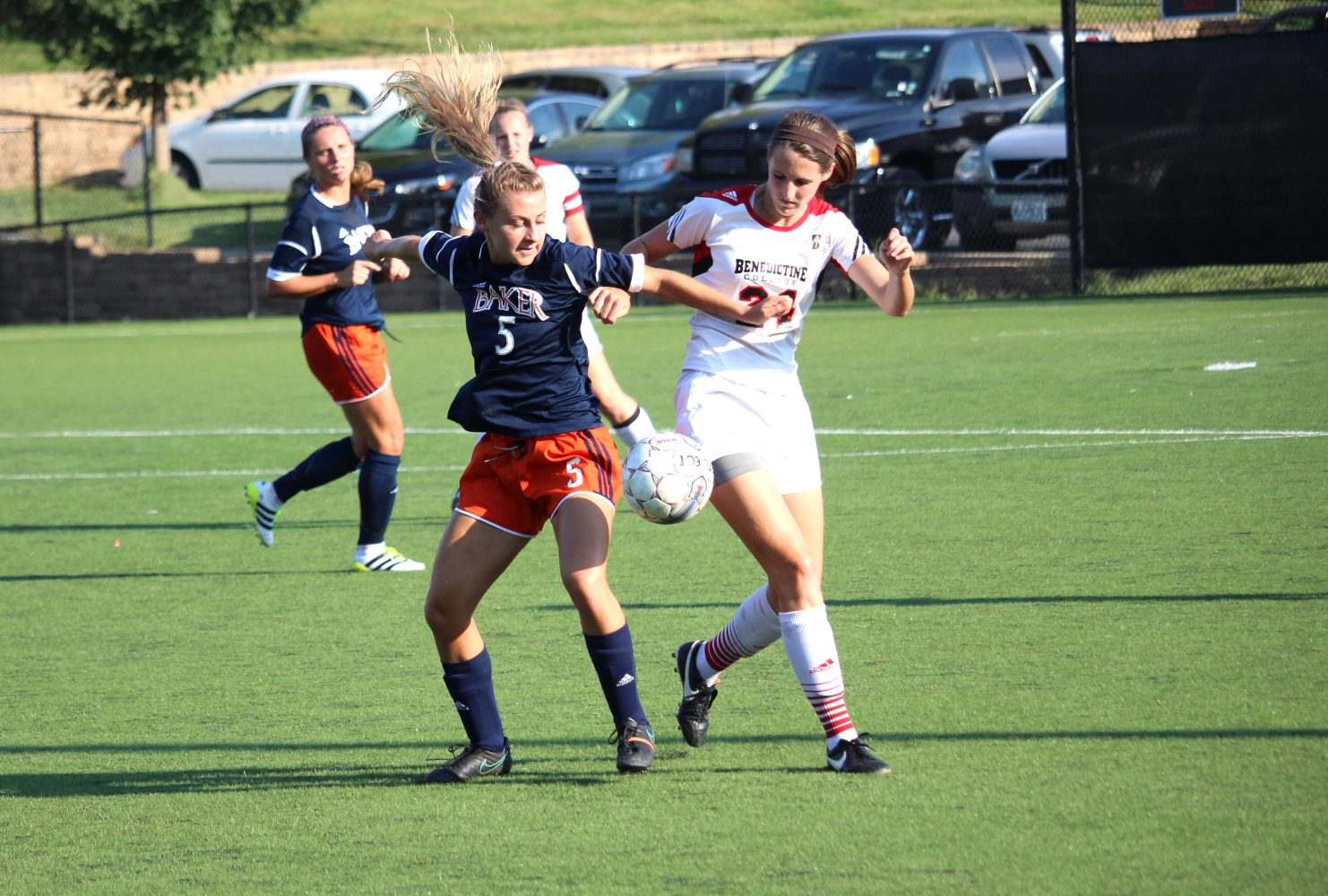 Freshman Erica Esch steps in front of Benedictine defender Hailey McEntee to gain control of the ball during Bakers 3-0 loss in Atchison on Sept. 21. Image by Bailey Conklin.