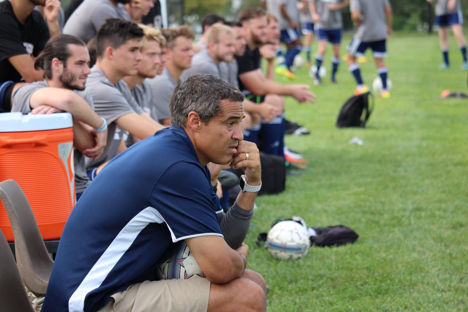 Head mens soccer coach Nate Houser oversees a Baker 2-0 win against Johnson County Community College in a scrimmage Aug. 12.