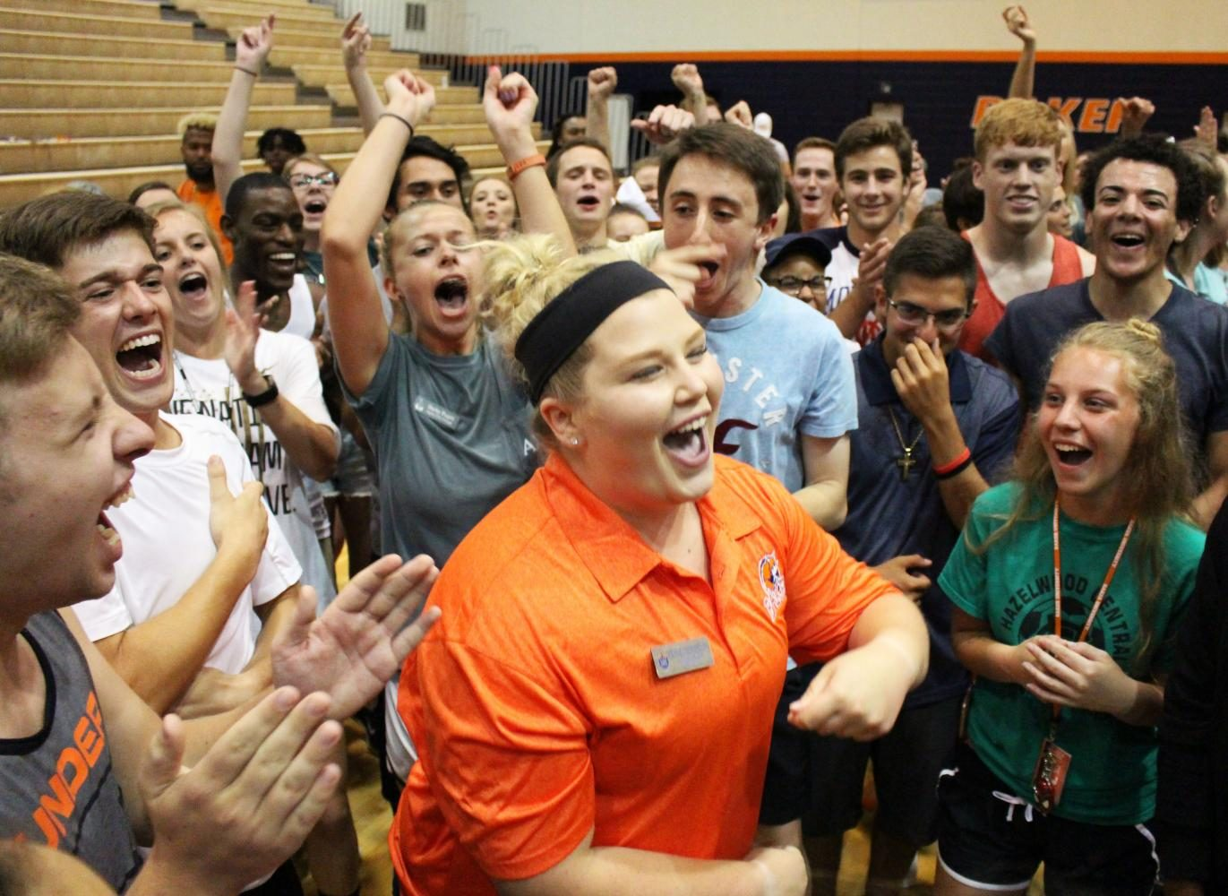 MK Ekins and surrounding students celebrate after Ekins wins a game of rock, paper, scissors at Playfair.