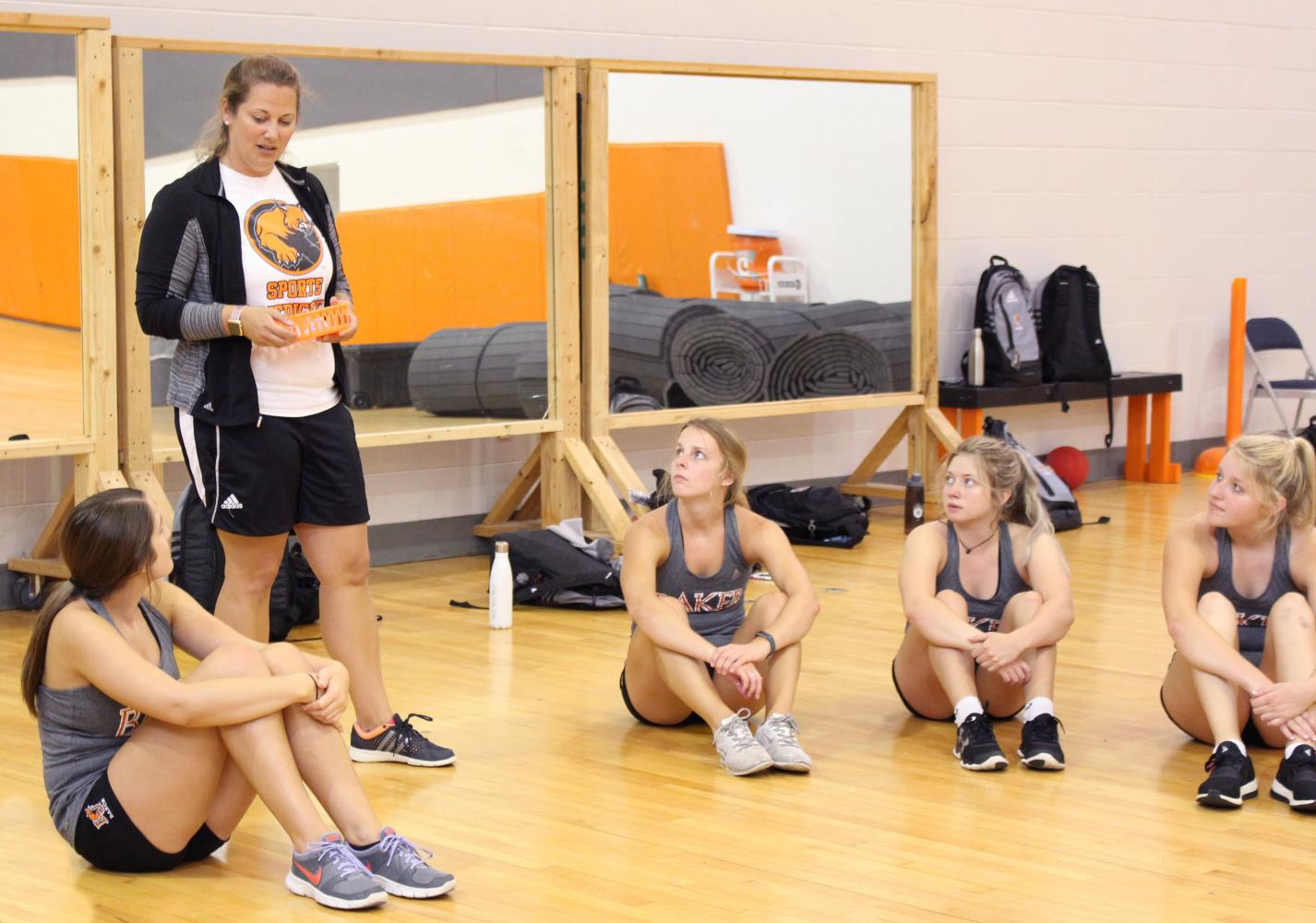 Head dance coach Lynsey Payne instructs dancers during a preseason practice inside Mabee Gym August 14.