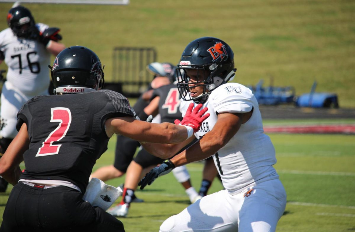 Senior Clarence Clark blocks Keegan Bell preventing him on the play. Clark managed four catches totaling in 125 yards with two touchdowns during Saturday's game.
