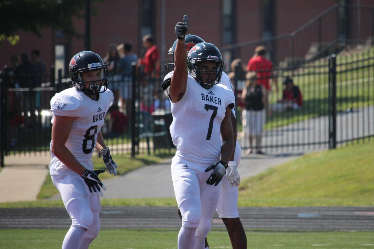 Wide receiver Clarence Clark gives the coaching staff a thumbs up after scoring one of his two touchdowns of the game. This is Clark's signal to the coaches that he is good to kick the extra point.