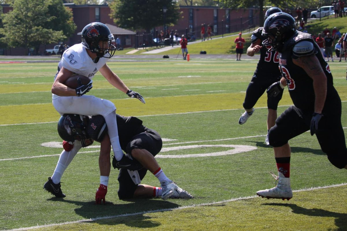 Freshman wide receiver Nick Snider attempts to break away from a tackle. Snider had nine catches totaling 124 yards and two touchdowns against Benedictine.