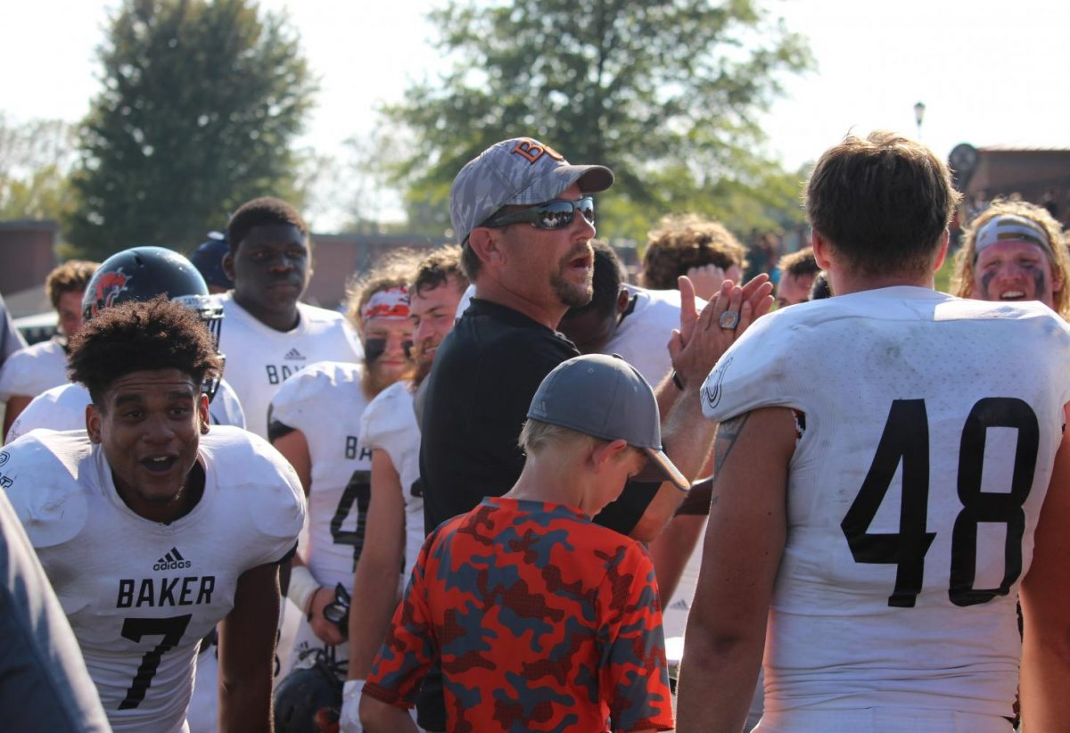 Coach Grossner gives the Wildcats a victory speech after celebrating the 44-37 win over Benedictine. This was Baker's 22nd-consecutive Heart of America Athletic Conference win.