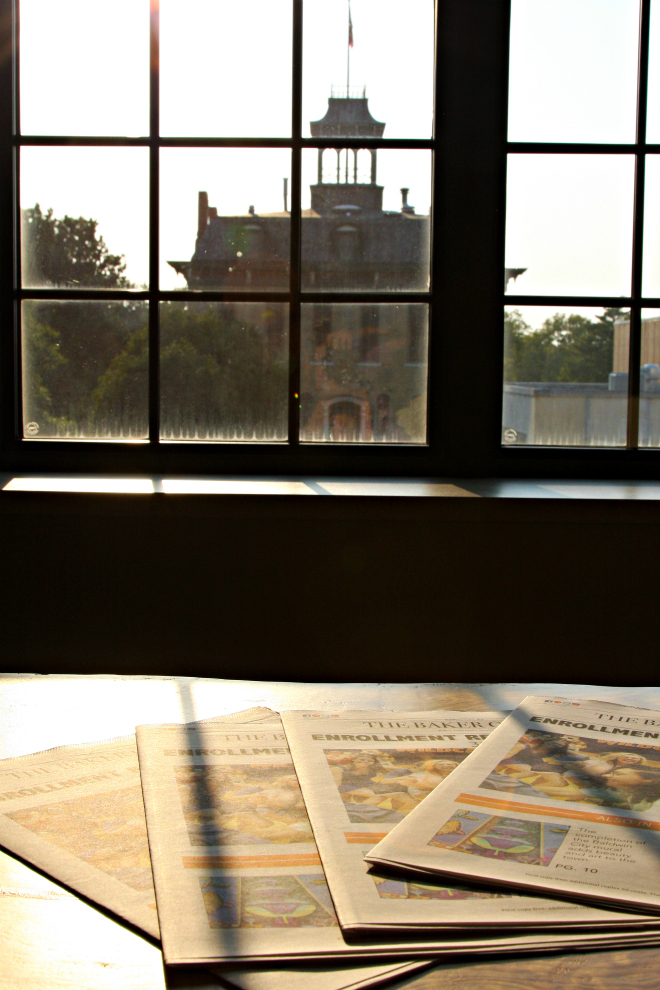 Photographer Carody Franklin looks out a window Mulvane onto ParMentor Hall.