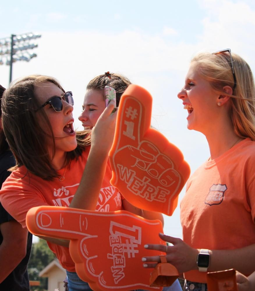 Baker fans enjoy the exciting moments of the football game Sept. 16, as well as capture it on social media. The game was an