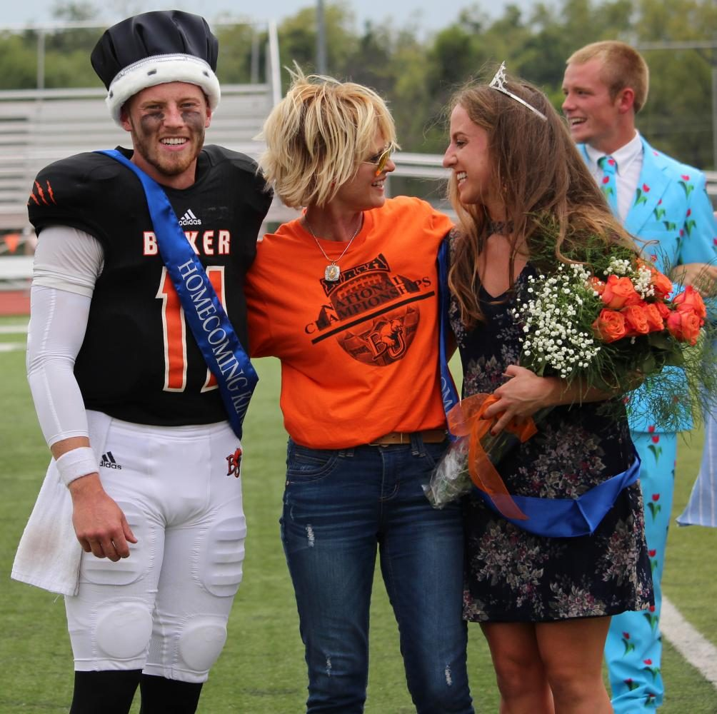 Homecoming queen, senior Madeline McCrary laughs with President Lynne Murray during the coronation of homecoming king and queen on Saturday, Sept. 16. Senior Logan Brettell was crowned Homecoming king.