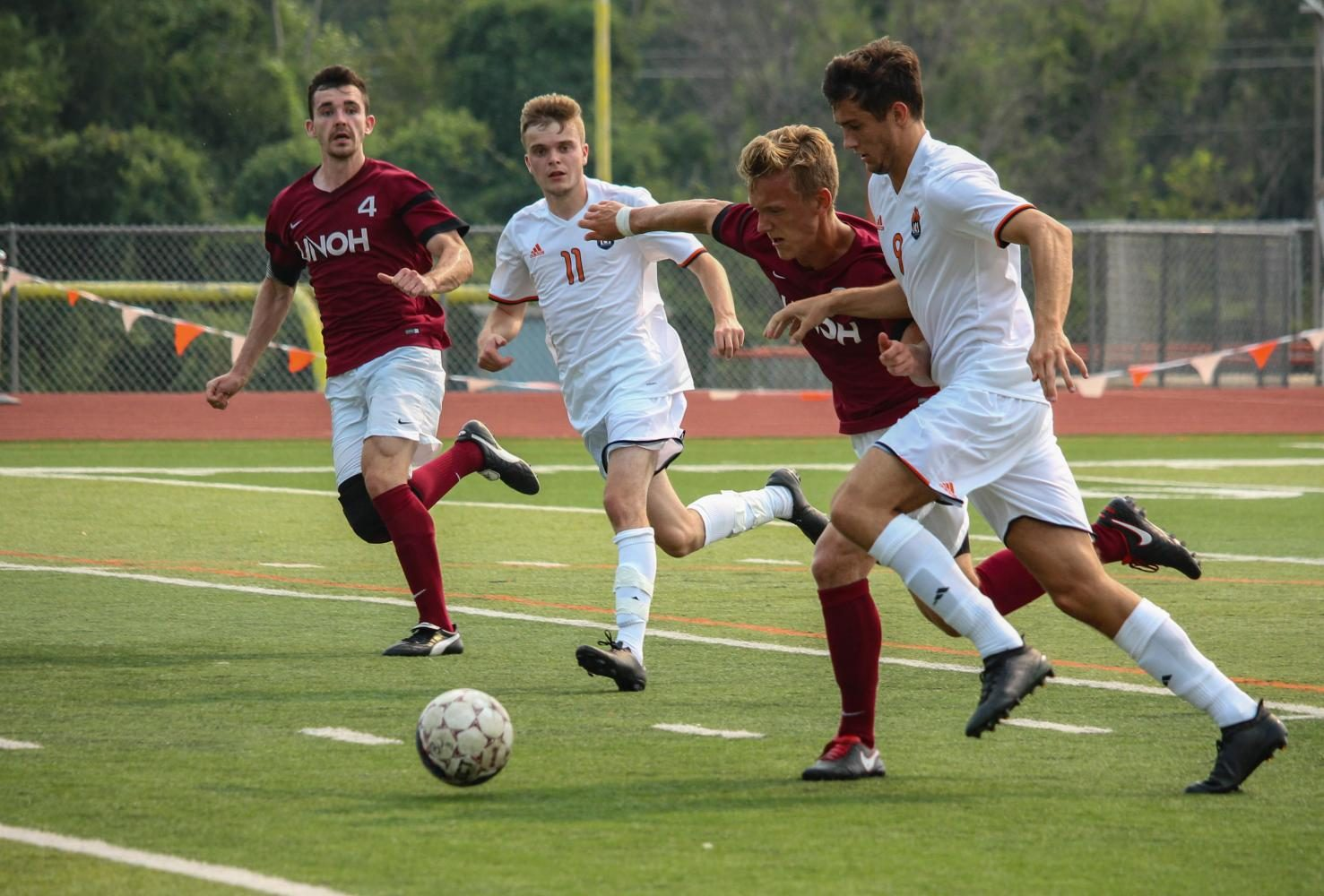 Joseph Houlihan and Jack Adamson work together to push the ball down field.