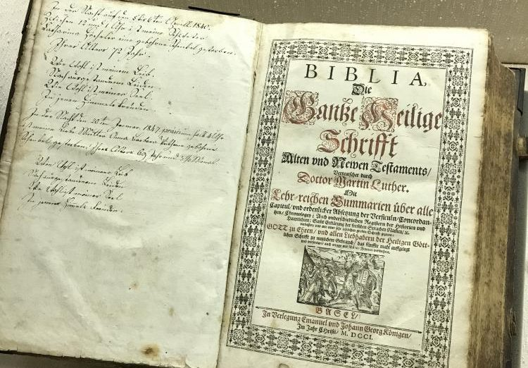 One of John Luther's translations of the Bible with a German family's writing on the side. This is a newer Bible, written in the 1700's.
