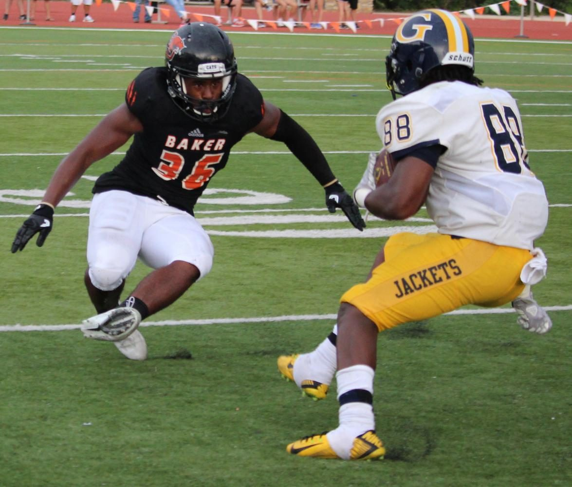 Linebacker, Khalid Farrakhan, rushes to tackle Graceland's wide receiver, Jaylin McCarty, during the game Sept. 16.