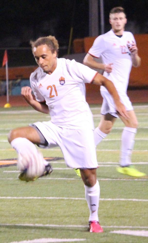 Junior Jordan Evans tries to regain control of the ball during Saturday night's game.