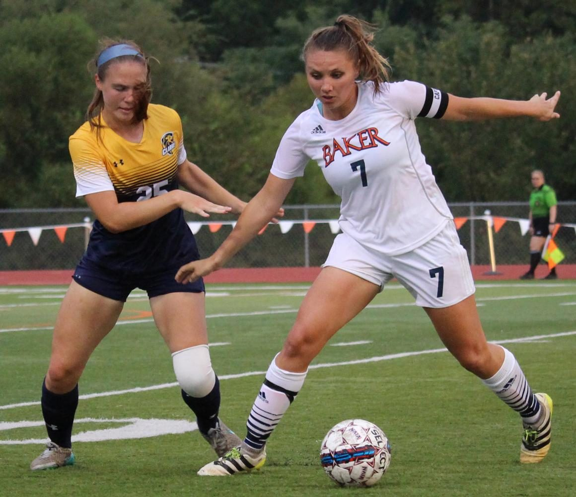 Senior Megan Johnson defends the ball from Clarke University's defender, Jenny Wicks.