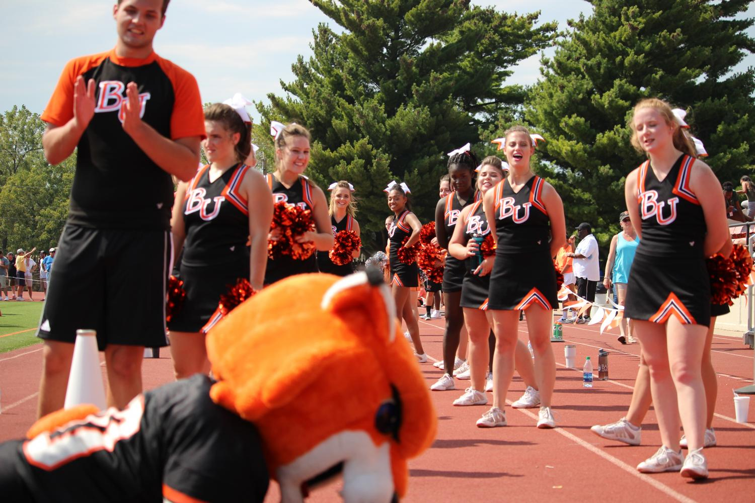 Entertaining the crowd, Wowzer the Wildcat does pushups for touchdowns while the cheerleaders count out loud.