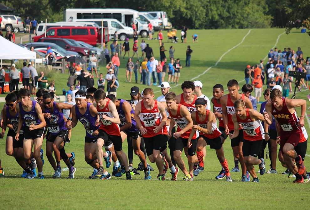 The men's team toes the line for their 5K race at the Baldwin City Golf Course Sept. 2. The men finished fourth as a team with 101 points.