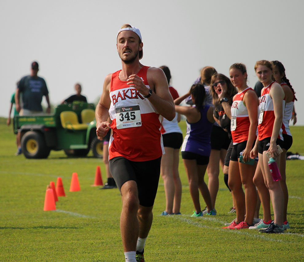 Junior Cole Stallard finishes the 5K race at the Baldwin City Golf Course. The men's typical race distance is an 8K.