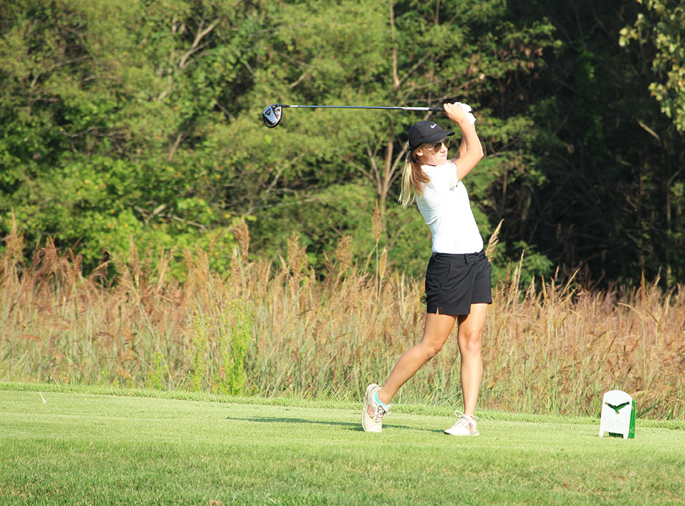 Teeing off at Eagle Bend Golf Course, sophomore Hannah Daugherty contributes to the women's fourth place finish at the Ottawa Fall Invitational. Daugherty placed 23rd individually.