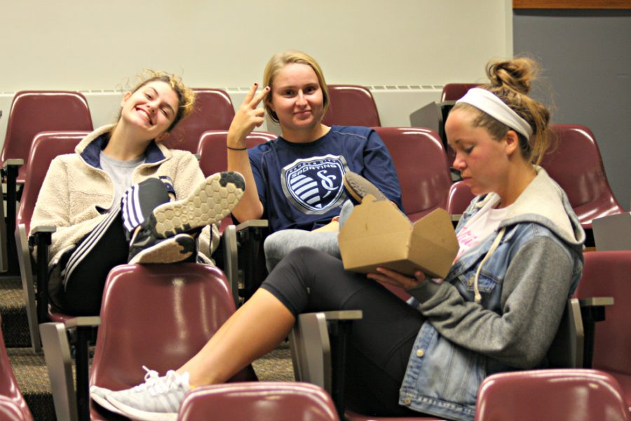 Speech Choir members, Sam Mitchell, Chloe Rodenbeek and Holly Chestnut get in a group in the beginning of class. The class is instructed to tell one another about the funniest thing they used to eat as a kid, and still eat today.