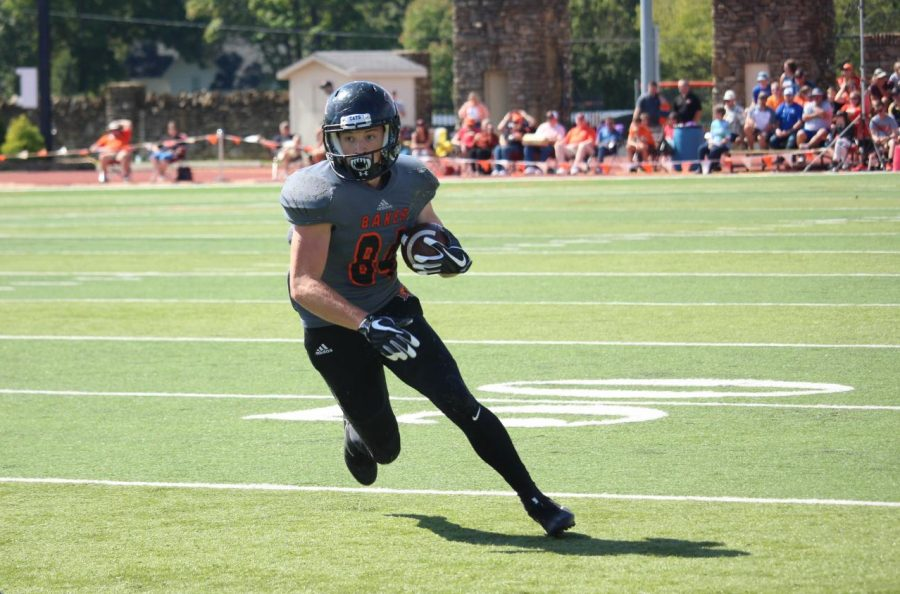 Freshman, Nick Snider looks to run down field after catching a pass. Snider would score a touchdown later in the drive.