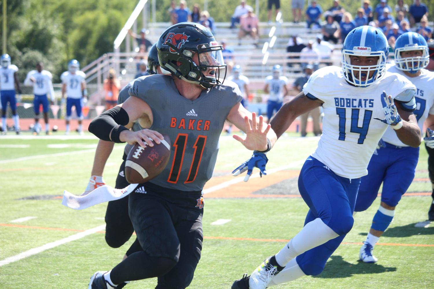 Quarterback Logan Brettell scrambles and looks for a receiver down field. Brettell would end the game with a school record of 84 career touchdown passes.