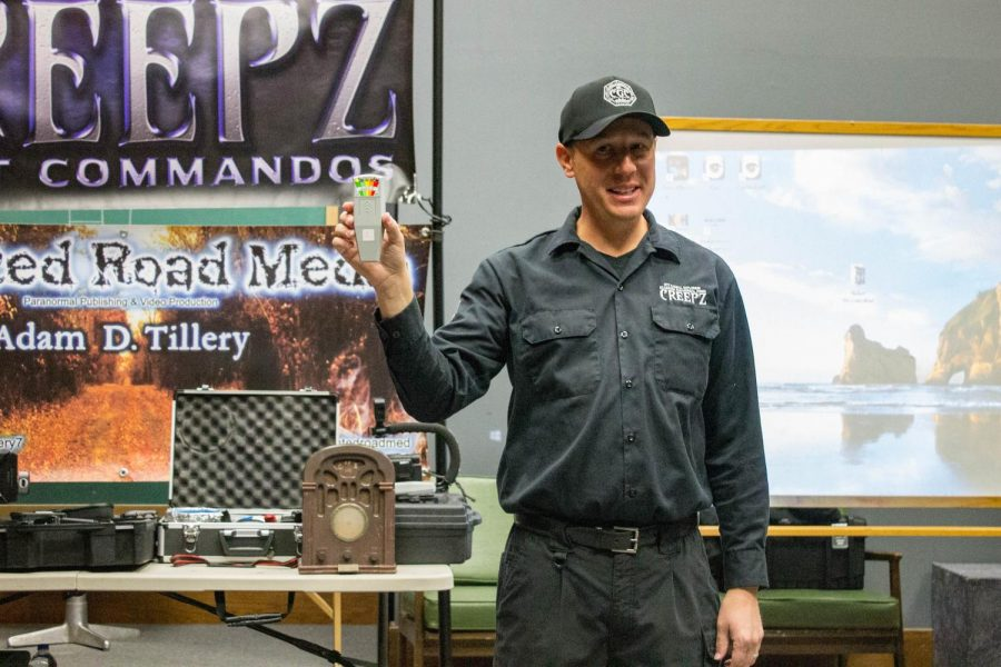 Alec Tillery, a team member of C.R.E.E.P.Z. Ghost Commando, holds up a K2 Meter. This device is used for measuring electromagnetic energy in a room. It was one of many devices used on the investigation Saturday night.