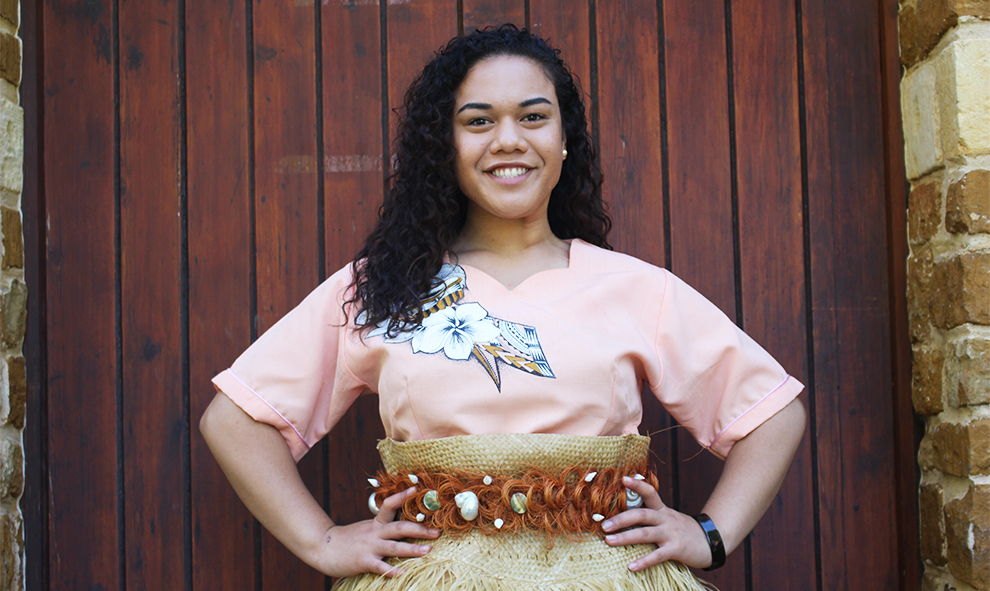 Folauhola (Lela) Hautau poses for a photo outside Osborne Chapel in her traditional clothing. Hautau enjoys singing and can only be described as kind, genuine, and loving by Dean of Students, Cassy Bailey.