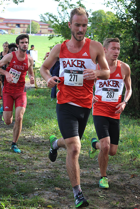 Junior+Cole+Stallard+and+senior+Johnny+Fulkerson+run+through+the+muddiest+part+of+Saturday%27s+course.+Runners+passed+this+part+of+Haskell%27s+historic+Billy+Mills+trail+three+times+during+the+men%27s+8+kilometer+%284.97+miles%29+race.+Fulkerson+and+Stallard+ran+together+for+the+majority+of+the+race%2C+but+Stallard+pushed+ahead+finishing+43rd+with+Fulkerson+slightly+behind+finishing+57th.