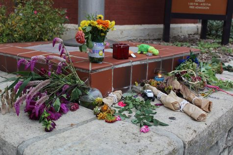 A small memorial is assembled at the corner of 11th and Massachusetts street in honor of three people who lost their lives Oct. 1. Items gathered at the memorial included flowers, candles and more.