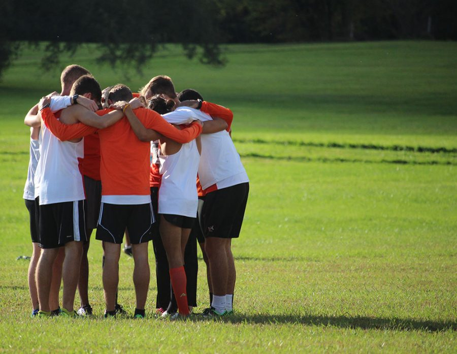 At the start of every race, the men huddle together for final words before toeing the line. Senior Joe Linder always gives a small speech to his teammates to make sure everyone is ready to race.